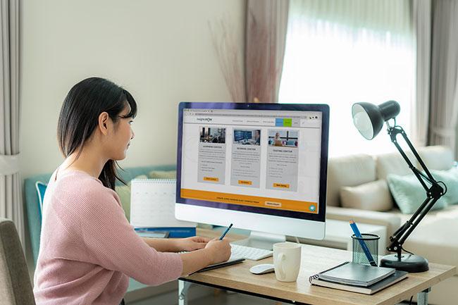 Woman using DIY qualitative research tools on desktop computer